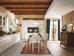 Cucina rustica in ambiente arredato con elementi quali pietra e legno